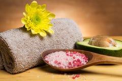 Sea salt, towel and avocado Stock Image