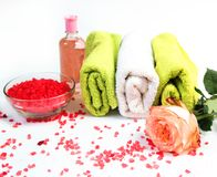 Sea salt, towels,dry bath bomb, tea candles, aroma oil in bottles and lavender on background.Flat lay. Spa cosmetic products.Spa t Royalty Free Stock Photography