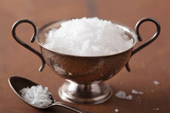 Sea salt in vintage bowl and spoon Stock Photo
