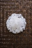 Sea salt on weaving bamboo Royalty Free Stock Photos