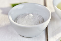 Sea salt in a white dish Royalty Free Stock Photography