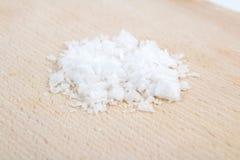 Sea salt on wood Stock Image