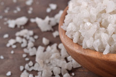 Sea salt in a wooden bowl Stock Photography