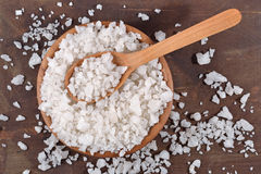 Sea salt in a wooden bowl Royalty Free Stock Images