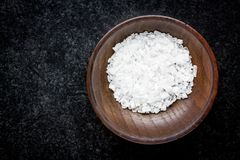 Sea salt in a wooden bowl Royalty Free Stock Photography