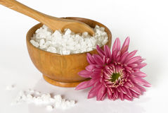 Sea salt in a wooden bowl with flower Stock Images