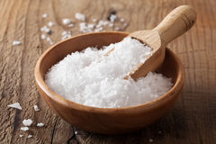 Sea salt in wooden bowl and scoop Stock Photography