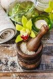 Sea salt in wooden mortar Stock Photo