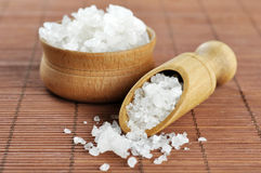 Sea salt in wooden scoop Royalty Free Stock Photos