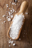 Sea salt in wooden scoop Stock Photography
