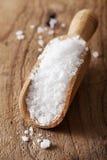 Sea salt in wooden scoop Royalty Free Stock Images