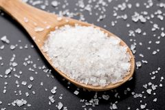 Sea salt in wooden spoon Stock Images