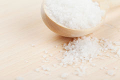 Sea salt in wooden spoon Stock Photos
