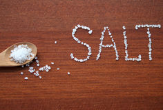 Sea salt in wooden spoon Royalty Free Stock Photo