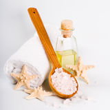 Sea salt on wooden spoon, towel, oil and stars Stock Photo