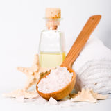 Sea salt on wooden spoon, towel, oil and stars Royalty Free Stock Images