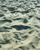 Sea of Sand. Lump, bumps and ripples of sand on beach Stock Image