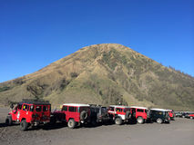 The sea of Sand parking lot below Mount Bromo, Indonesia Stock Photos