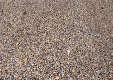 Sea sand, pebbles and seashells Stock Image