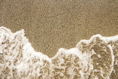 Sea sand and rocks with wave Stock Photography