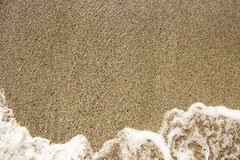 Sea sand and rocks with wave Stock Photo