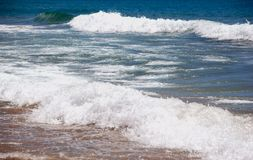 Sea, sand and sea wave on the beach.  Royalty Free Stock Photography