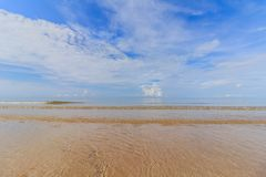 Sea sand sky and soft wave of blue ocean on sandy beach summer d Stock Images