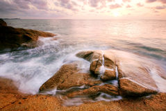 Sea sand sun beach sunset sunrise thailand stone rock beach land Royalty Free Stock Images