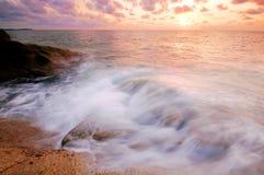 Sea sand sun beach sunset sunrise thailand stone rock beach land Royalty Free Stock Image