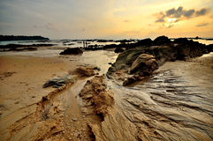 Sea sand sun beach sunset sunrise thailand stone rock beach land Royalty Free Stock Photos
