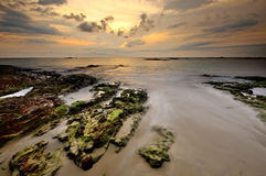 Sea sand sun beach sunset sunrise thailand stone rock beach land Royalty Free Stock Photography