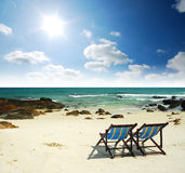 Sea sand sun beach together blue sky. Chair alone background design stone clear royalty free stock photos