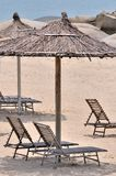 Sea sand sunshade and chair Royalty Free Stock Photos