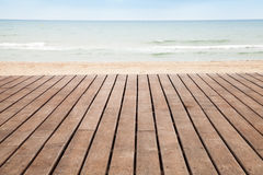 Sea, sand and wooden pier perspective Stock Photography