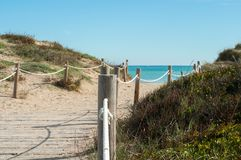 Sea with sandy beach. Path to the sea on a sandy beach royalty free stock photography