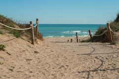 Sea with sandy beach. Path to the sea on a sandy beach stock image