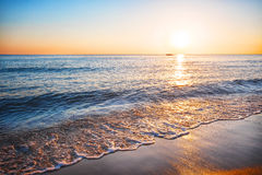 Sea sandy beach with surf Royalty Free Stock Images