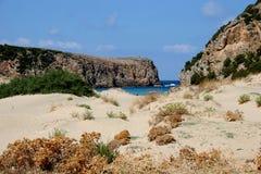 Sea sardegna italy. The sea beach water unpolluted blue frame around a rocky royalty free stock photos
