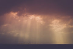 Sea scape. A dark, moody seascape with rays of sunlight Royalty Free Stock Photo