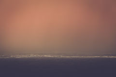 Sea scape. A dark, moody seascape with rays of sunlight Stock Photos
