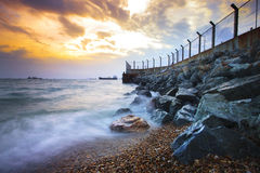 Sea scape at rock dam protection coast from wave impact against Royalty Free Stock Photos