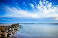 Sea scape with rocks and clouds. Long exposure Royalty Free Stock Images