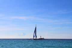 Sea-scape with a sailing boat Stock Image