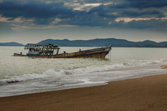 Sea scape of wreck boat on beach Royalty Free Stock Image
