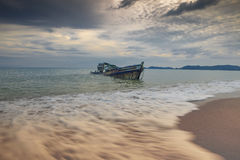 Sea scape of wreck boat on sea beach Royalty Free Stock Images
