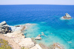 Sea scene with transparent water and rocky coast in Greece Stock Image