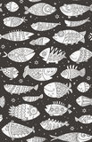 Sea seamless pattern with decorative fish in childish style Stock Images