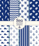 Sea seamless patterns. Vector collection. Set of sea and nautical seamless patterns in white and navy blue colors. Vector illustration Stock Image