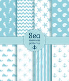 Sea seamless patterns. Vector collection. Set of sea and nautical seamless patterns in white and pale blue colors. Vector illustration Royalty Free Stock Image
