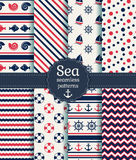Sea seamless patterns. Vector collection. Set of sea and nautical seamless patterns in white, pink and dark blue colors. Vector illustration Stock Photos